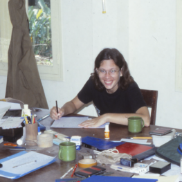 Karen Barnes at a table, surrounded by paperwork