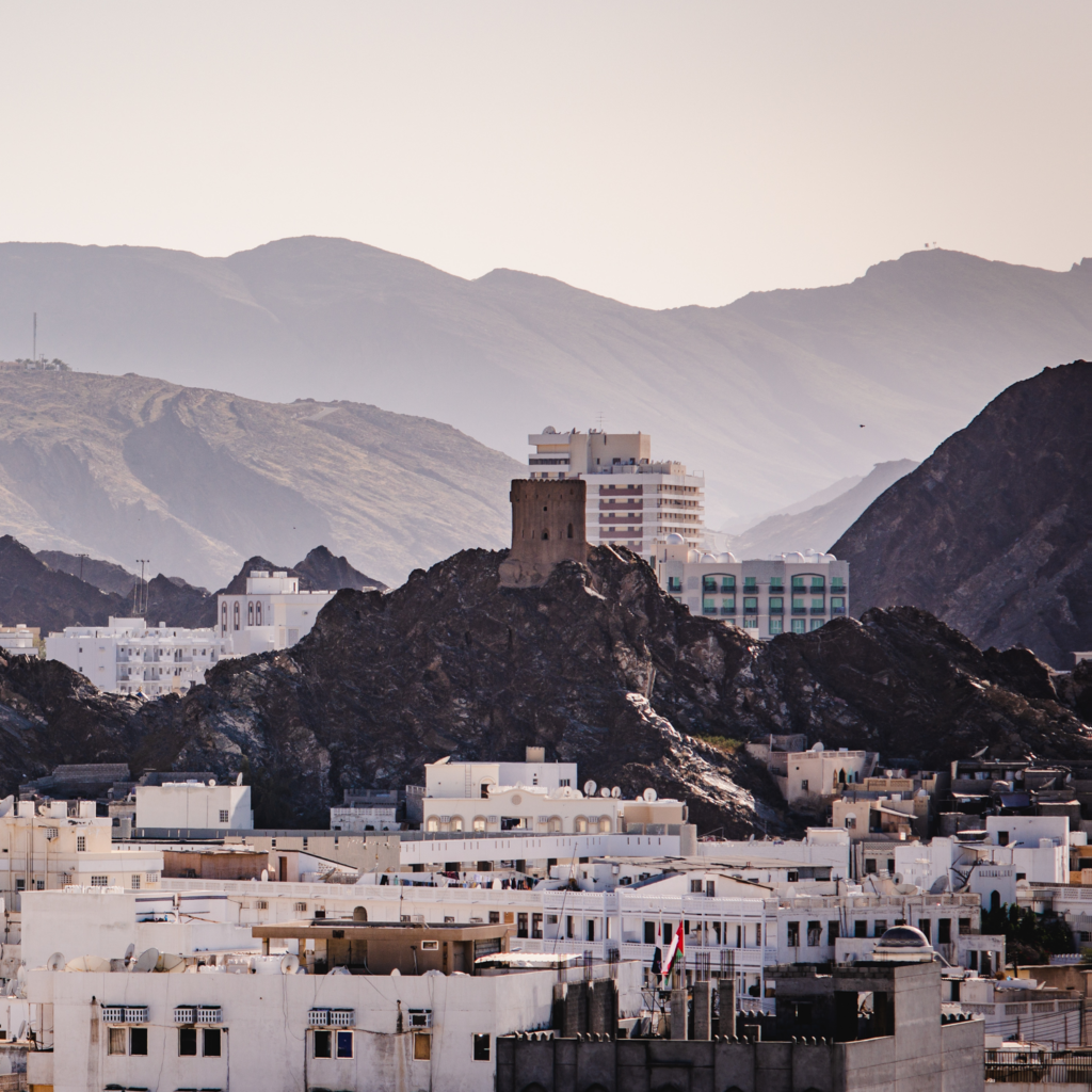 A blending of mountains and architecture in Muscat, Oman. Photo by Dawid Zyla.