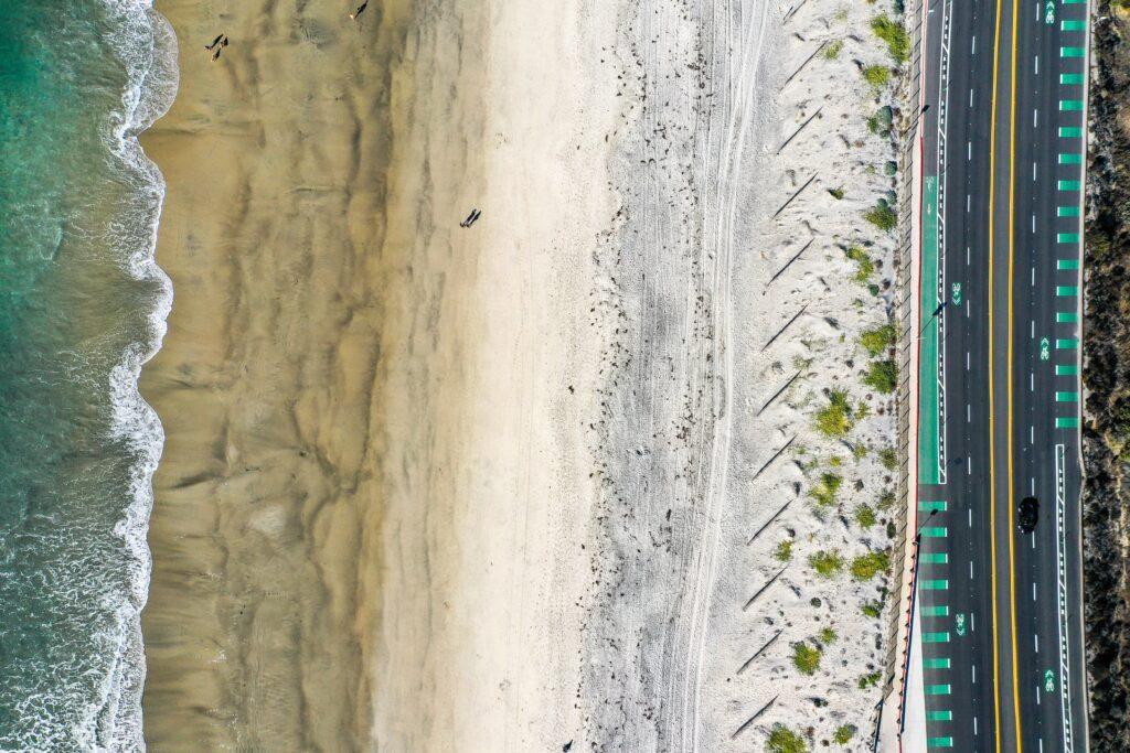 Drone shot of a San Diego beach. Photo by Dawid Zyla.